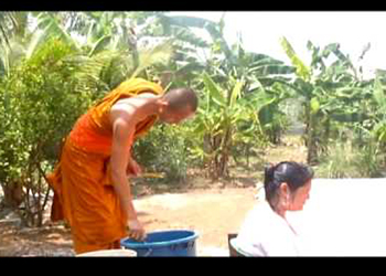 Buddhist Monk Blessing and Showering